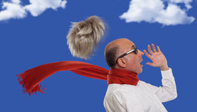 Man's toupee blown away by wind Royalty Free Stock Photo