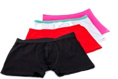 Man's underware. In black, red, white and pink Stock Photo