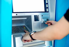 Man's using the ATM machine Royalty Free Stock Photos