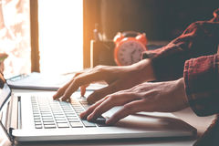 Man`s using laptop on desk in home interior. Business concept.  royalty free stock photo