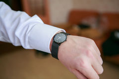 Man's watch on the wrist. Black man's watch on the wrist Stock Photo