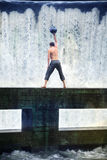 Man's weight ball training in nature Stock Photography