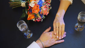 Man`s and woman` hands on the table in cafe - wedding concept Royalty Free Stock Photography