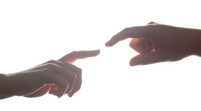 Man's and woman's hands, fingers reaching each other. Love, connect, help concepts. Royalty Free Stock Photos