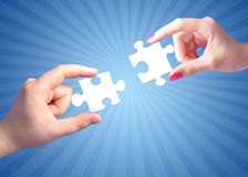 Man's and woman's hands with puzzles. Hands holding puzzle. Communication conceptual image royalty free stock photo