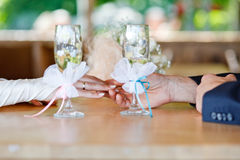 Man's and woman's hands on the table Royalty Free Stock Photo