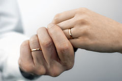 Man's and woman's hands with wedding rings. Close view of man's and woman's hands with wedding rings Stock Images