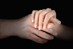 Man's and woman's hands with wedding rings Stock Photography
