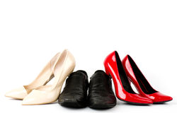 Man's and womanish shoes Stock Photos