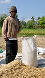 Man with sack of rice. Picture was taken on Lombok island (Indonesia) between Senggigi and Matharam Royalty Free Stock Images