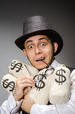 Man with sacks. Of money stock images