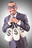 Man with sacks of money Stock Photography