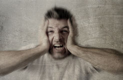 Man sad and depressed suffering depression feeling sorrow and pain screaming desperate Royalty Free Stock Images