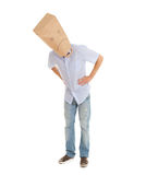 Man with sad paper bag on head, full length Royalty Free Stock Photo