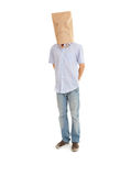 Man with sad paper bag on head, full length Royalty Free Stock Image