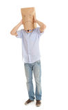 Man with sad paper bag on head, full length Royalty Free Stock Photos