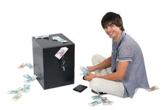 Man with safe and money Royalty Free Stock Photo