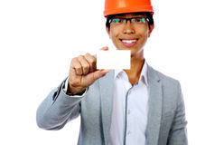 Man with safety helmet holding blank card Stock Images