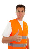 Man in safety vest. With thums up over white background Royalty Free Stock Images