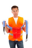 Man in safety vest. Holding cable line over white background stock photos