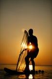 Man sailboarding at sunset Royalty Free Stock Images