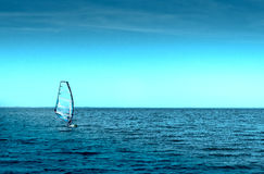 Man in Sailboards at sea, Windsurfing Stock Photo