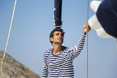 Man on sailboat. Young man posing for sailboat Royalty Free Stock Image