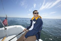 Man Sailing In Boat Stock Photo