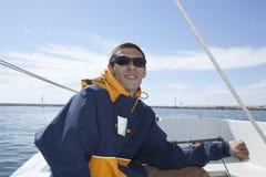 Man In Sailing Boat Royalty Free Stock Photos