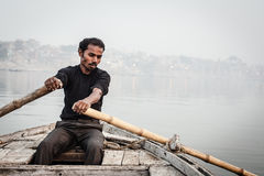 Man sailing on the boat on Ganges river Stock Photos
