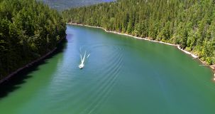 Man sailing in the boat on a sunny day 4K 4k. Aerial view of man sailing in the boat on a sunny day 4K 4k stock video footage