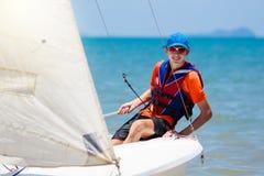 Man sailing. Boy learning to sail on sea yacht stock photo