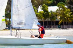 Man sailing. Boy learning to sail on sea yacht stock image
