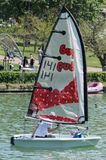 Man Sailing a Dinghy Stock Images