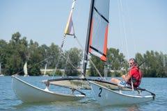 Man sailing on lake. Sailor stock photo