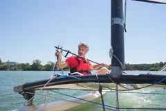 Man sailing with sails out on sunny day. Man sailing with sails out on a sunny day Stock Images