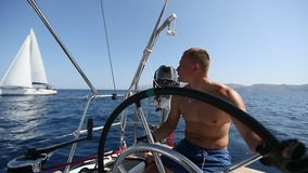 Man sailing yacht boat on the sea. Sport. stock video