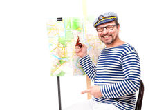 Man sailor in cap with smoking pipe, with globe and map, on whit Stock Photos