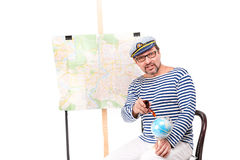 Man sailor in cap with smoking pipe, with globe and map, on whit Royalty Free Stock Photography