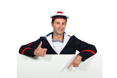 Man in sailor costume Stock Image