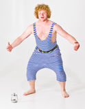 Man in Sailor Costume. Actor wearing a striped sailor costume stock image