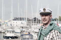 Man in a sailor's Cap on the deck of a sailboat Royalty Free Stock Photo
