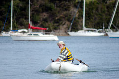 Man sails an inflatable boat Stock Photography