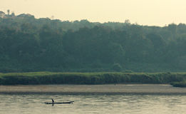Man sails on the Mekong in Chiang Khong, Thailand Stock Images