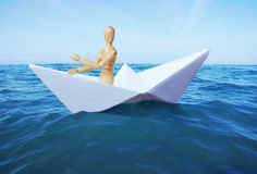 Man sails on the sea in a paper ship Royalty Free Stock Photos
