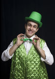 A man (Saint Patrick) smile in a green. Vest with a green hat and bow tie. It is St. Patrick's Day Stock Images