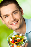 Man with salad Royalty Free Stock Image