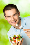 Man with salad Royalty Free Stock Photo