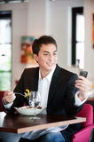 Man with Salad and Phone Royalty Free Stock Photography