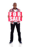 Man for sale sign Royalty Free Stock Photo